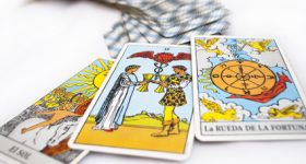 divination and prediction three Tarot cards the best choice, love, money and luck on a white background